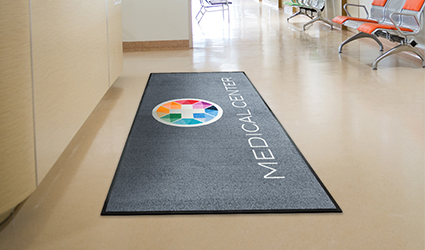 Jet-Print - grey Jet-Print mat at the reception desk in medical centre