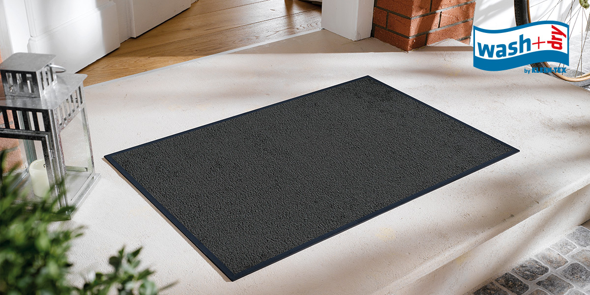wash+dry Original mat in smokey mount on doorstep
