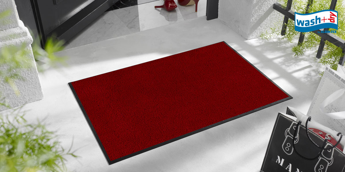 wash+dry Original mat in regal red on white doorstep